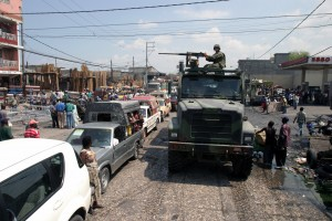040405-M-8172E-033 Port-Au Prince, Haiti (Apr. 5, 2004) - A 7-ton vehicle, part of a convoy carrying U.S. Marines assigned to 3/8 Kilo Company, makes its way through congested traffic and piles of debris in Port-Au Prince, the capital city of Haiti. U.S. Marine Corps photo by Cpl Eric Ely. (RELEASED)